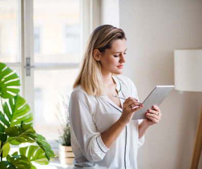 young-woman-with-tablet-indoors-in-home-office-wor-WCGTZVL